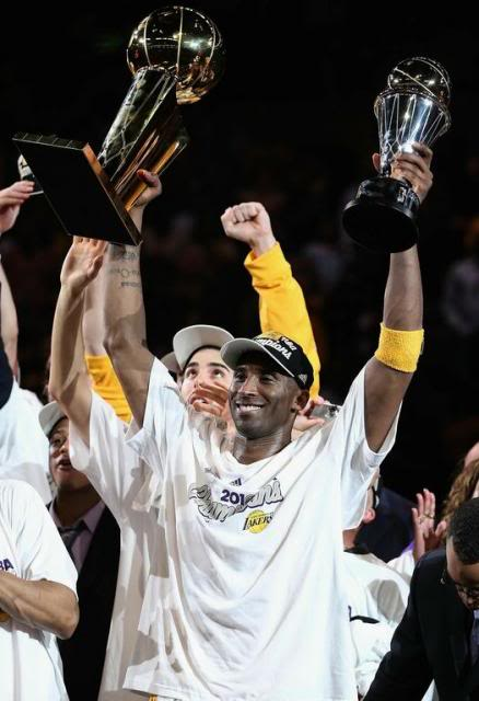 Kobe_Bryant_hoists_both_the_2010_NB